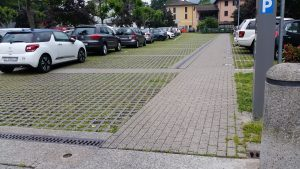 An example of permeable pavement used for a parking lot in Riva San Vitale.